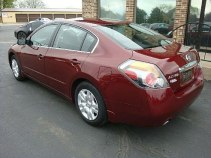 2012 Nissan Altima red form the back